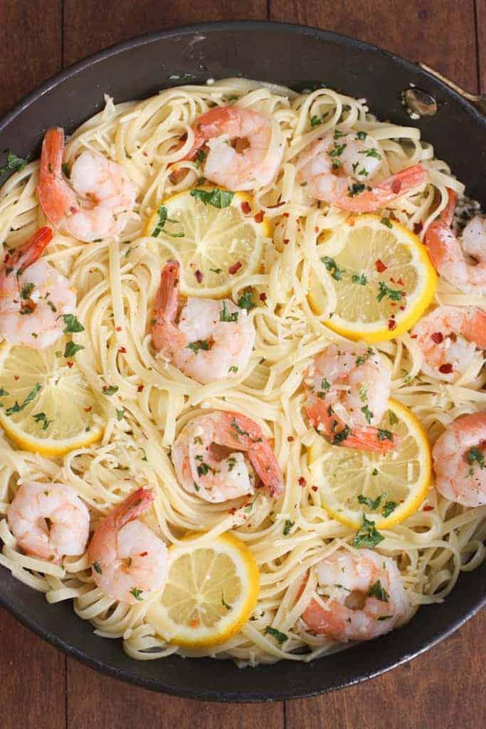 Shrimp scampi linguine in a pan.