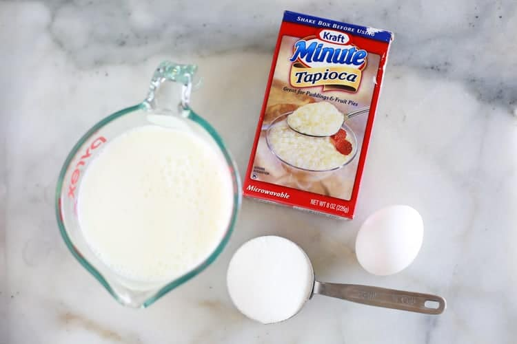 the ingredients for making tapioca pudding including milk, sugar, egg and tapioca.