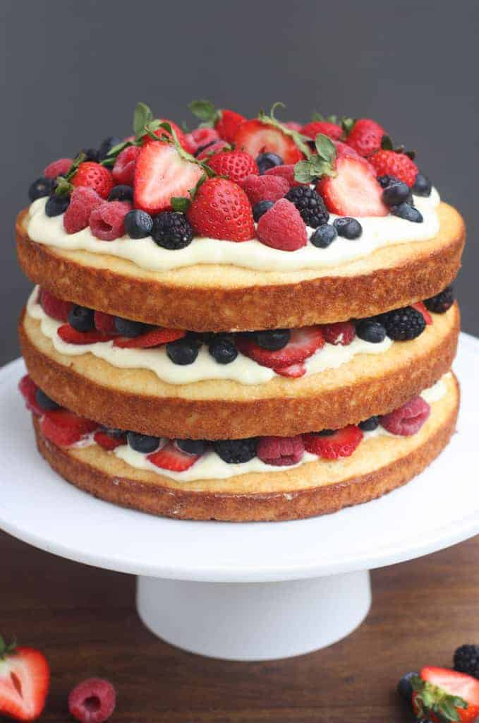 A three layer yellow Cake with Lemon Cream Mousse and fresh berries between each layer.
