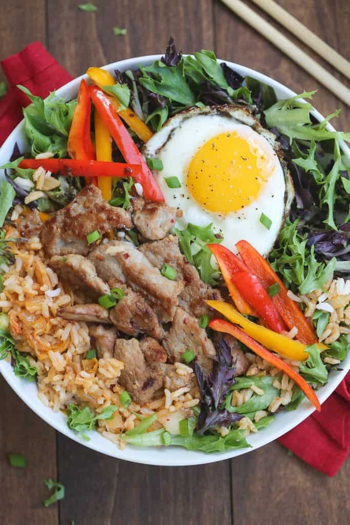 Korean Bulgogi Bowls | simple marinated bulgogi pork served over kimchi fried rice and leafy greens with a fried egg on top. Packed with flavor, these bowls are AMAZING! | Tastes Better From Scratch
