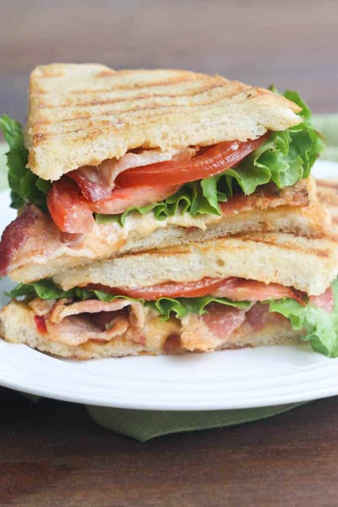 Pimento Cheese BLT Sandwich. A warm, cheesy sandwich made with sourdough bread, slathered with an easy homemade pimento cheese spread. Layered with bacon, lettuce and tomatoes. | Tastes Better From Scratch
