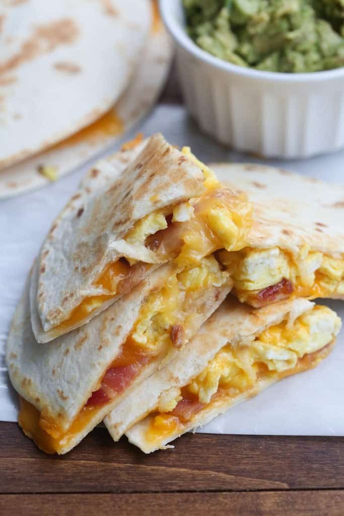 A Breakfast Quesadillas with bacon, egg and cheese cut into four triangles.