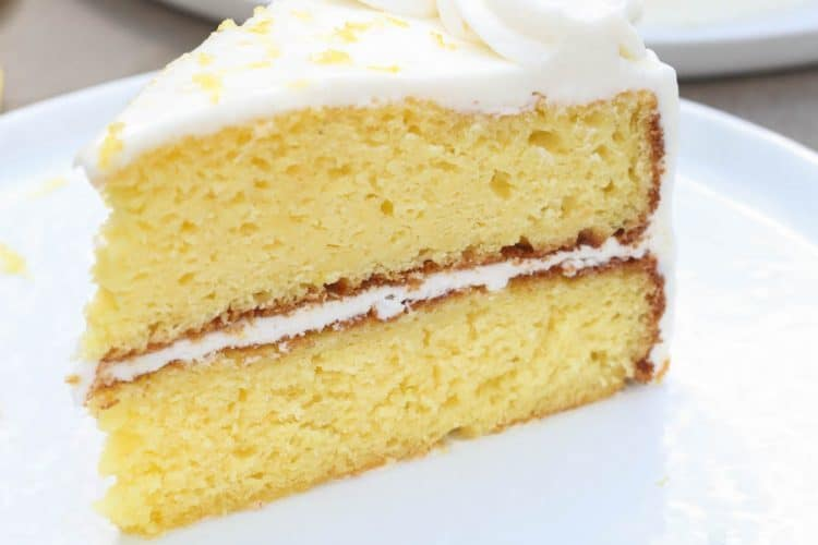 The BEST homemade Lemon Cake with a light Lemon Buttercream frosting. | Tastes Better From Scratch