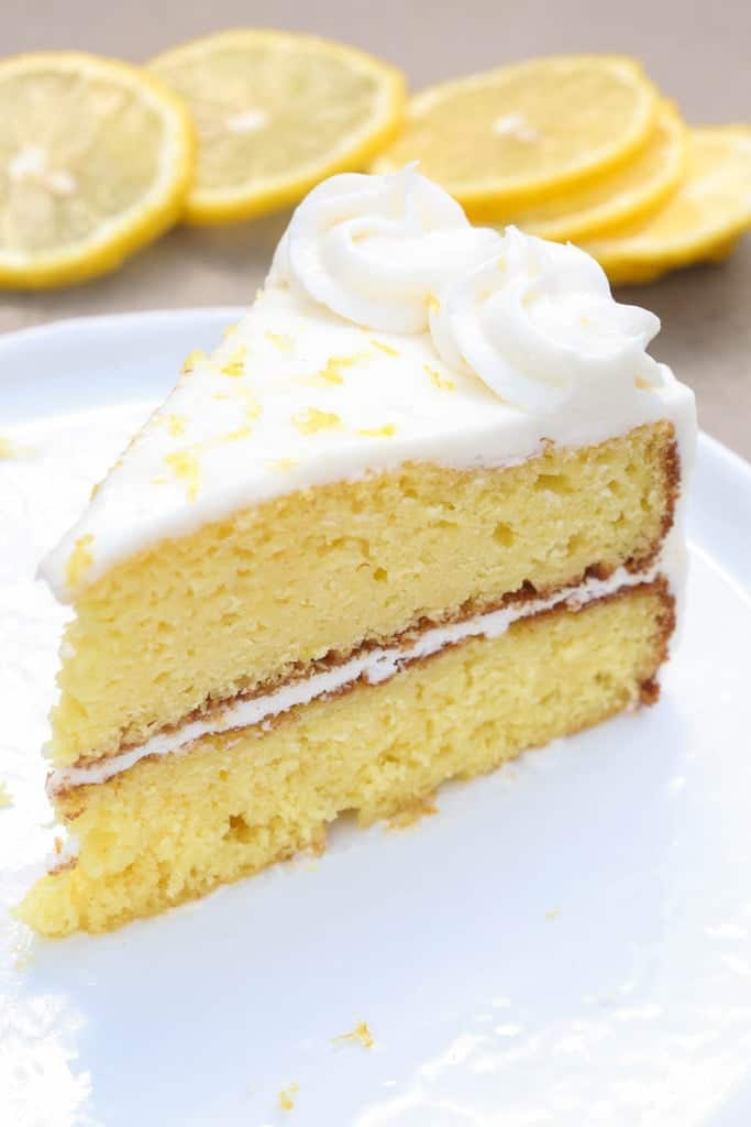 A double layer Lemon Cake with a light Lemon Buttercream frosting in between each layer as well as on top of the cake.