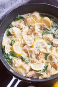 One Pan Creamy Lemon Chicken Tortellini - an easy one pan pasta dish that the entire family will love. Tortellini pasta with grilled chicken and fresh spinach in a warm, cheesy lemon garlic sauce. | Tastes Better From Scratch