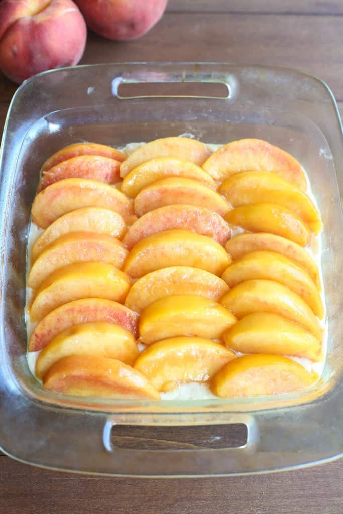 Fresh peaches layered in a 8x8 baking dish.