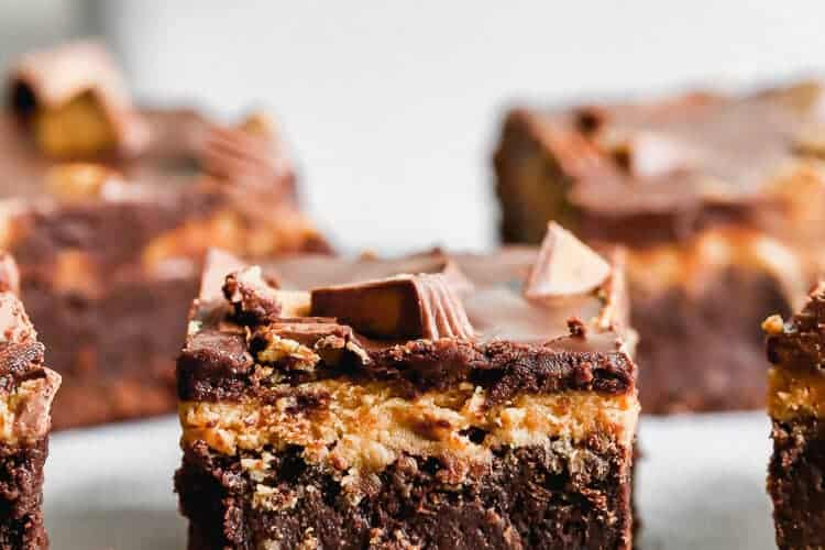 A Peanut Butter Brownie on a wire cooling rack with more brownies in the background.