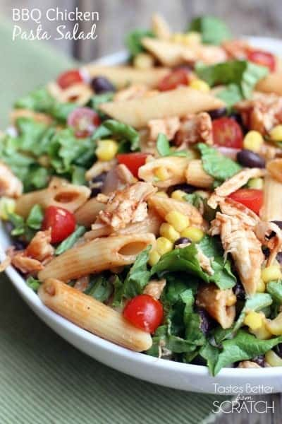 BBQ Chicken Pasta Salad with penne pasta, black beans, corn, tomatoes, and cheese over a bed of green lettuce.  Mmm good! | tastesbetterfromscratch.com
