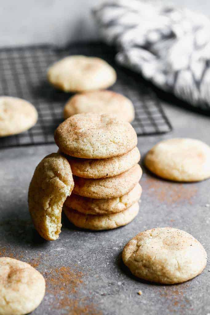 A stack of 5 snickerdoodles and another propped on the side.