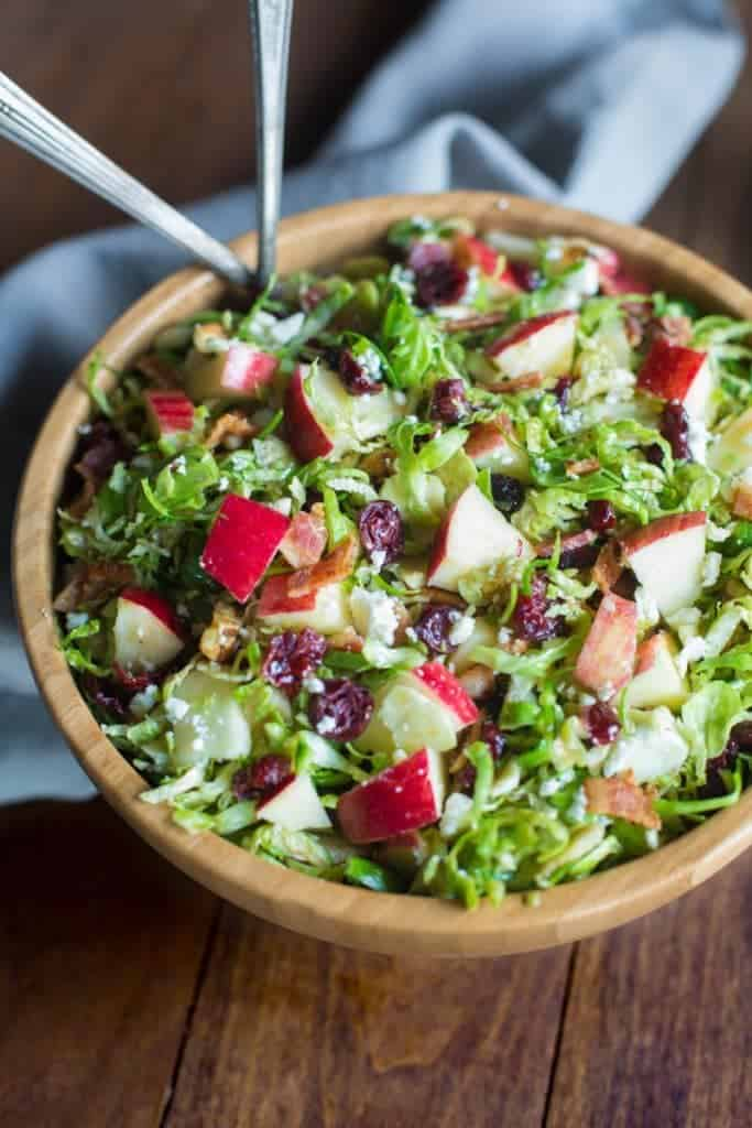 A bowl filled with Brussels Sprout Salad with Cranberries and Pecans.