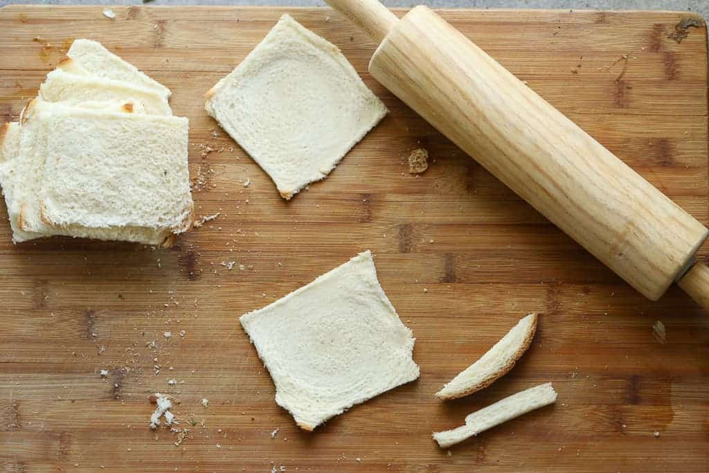 Slices of bread rolled flat with a rolling pin.