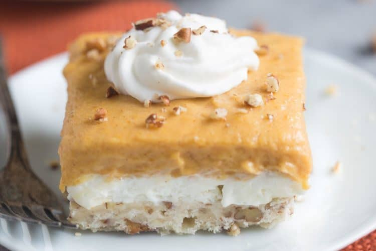 Pumpkin Dream Desert is a layered pudding dessert with a soft shortbread crust, whipped sweet cream cheese layer and pumpkin pudding layer. We love this easy fall dessert! | Tastes Better From Scratch
