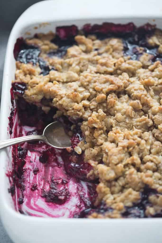Triple Berry Crisp with a portion missing from the front left corner.