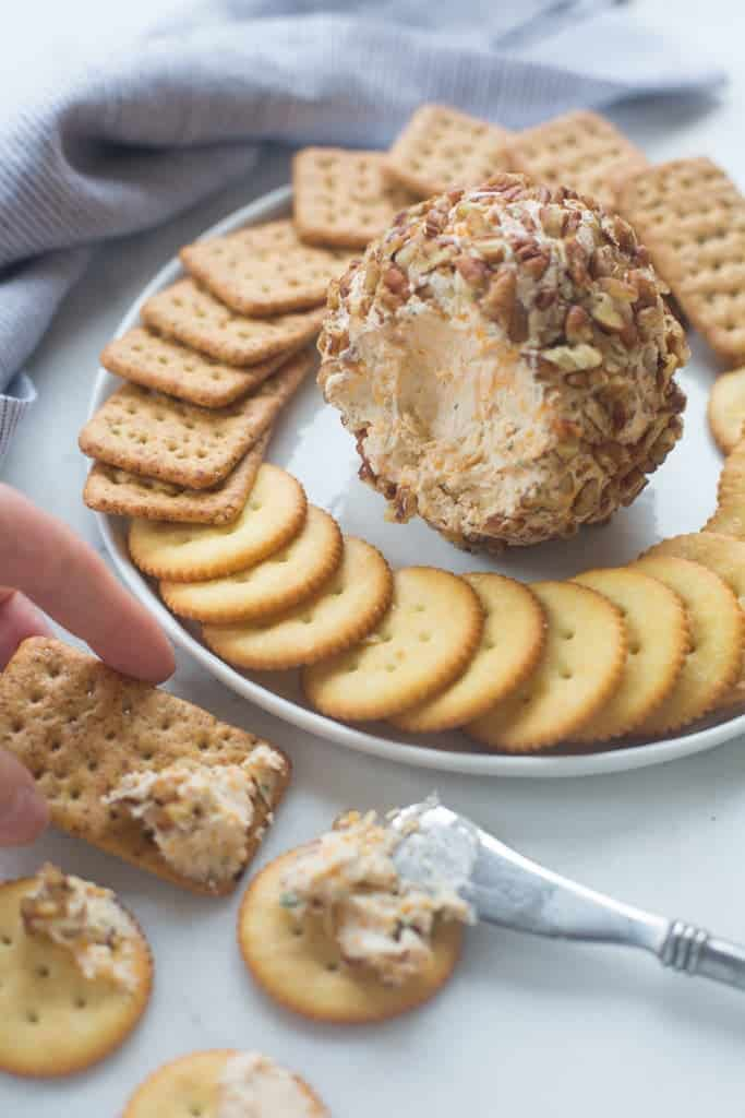 Classic Cheese Ball recipe made with real cheddar cheese, cream cheese, green onion and coated in chopped pecans. The BEST easy holiday appetizer that everyone loves! | Tastes Better From Scratch