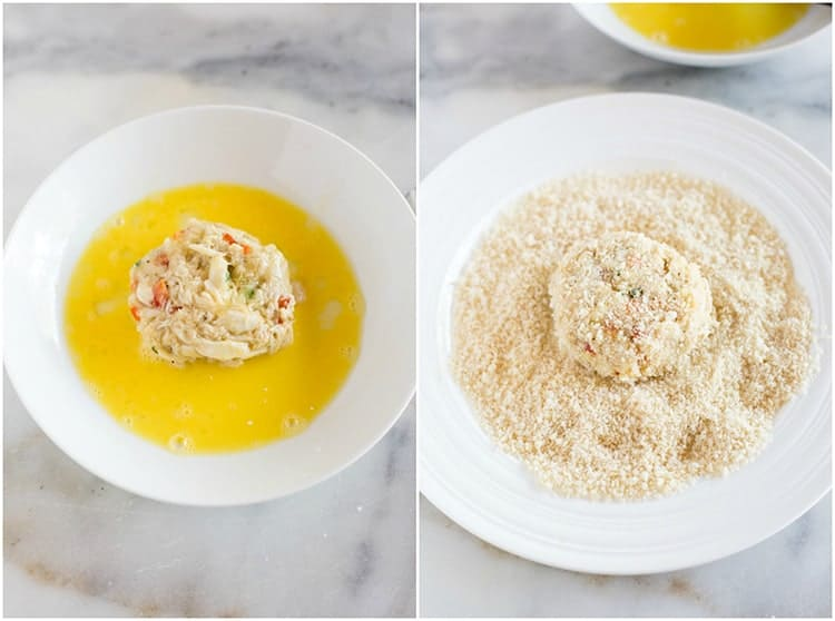 Crab cake being dipped in a bowl with beaten egg yolks and then in a bowl with panko bread crumbs.