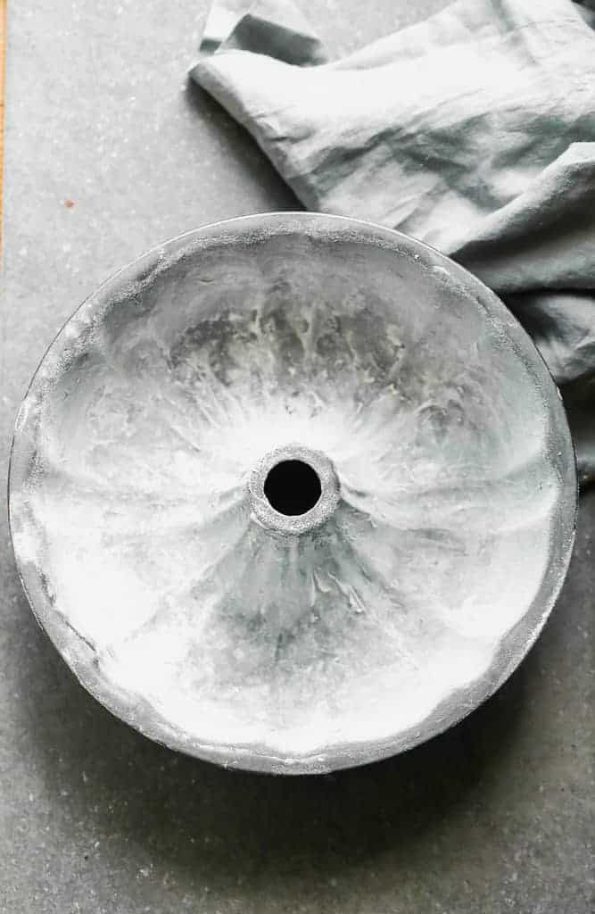 A bundt pan greased with shortening and flour.