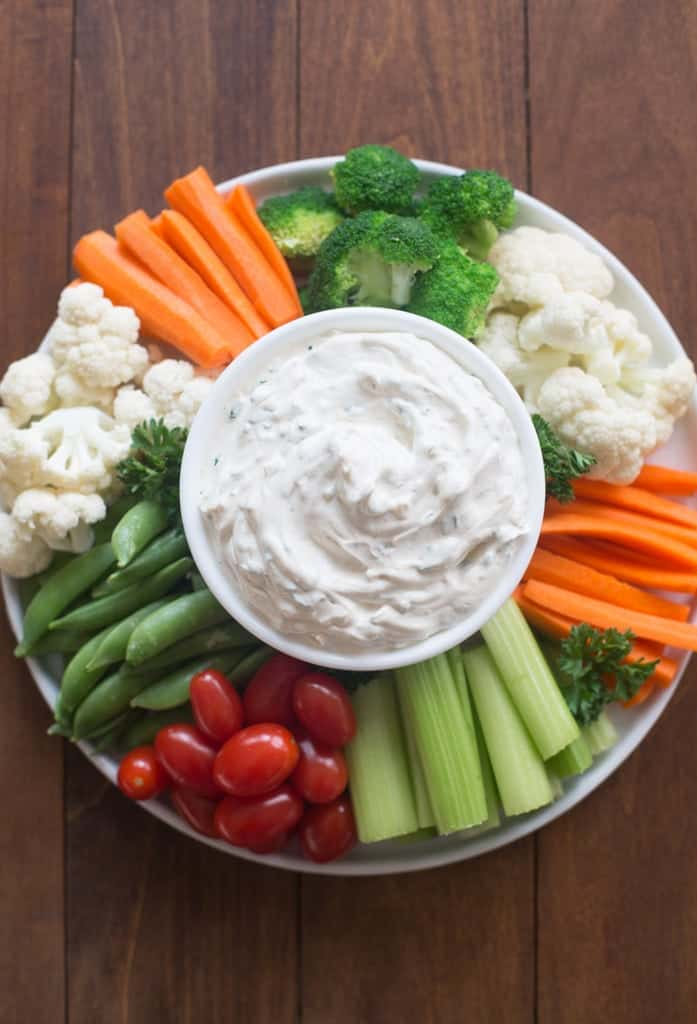 Easy Vegetable dip surrounded by vegetables