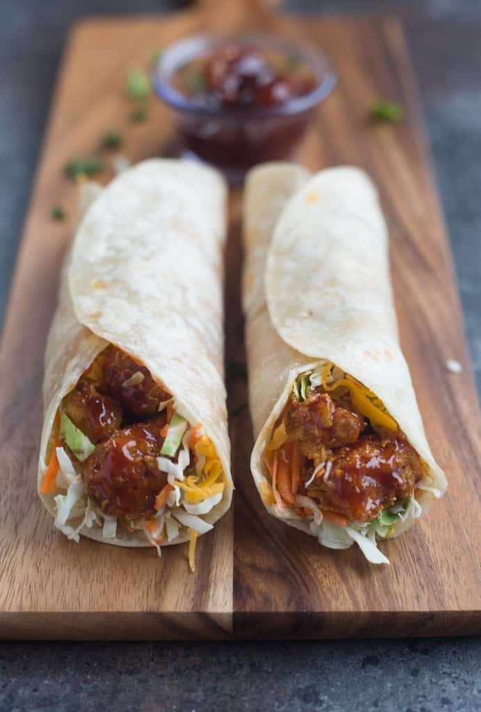 BBQ Chicken with cabbage and cheese wrapped in a tortilla.