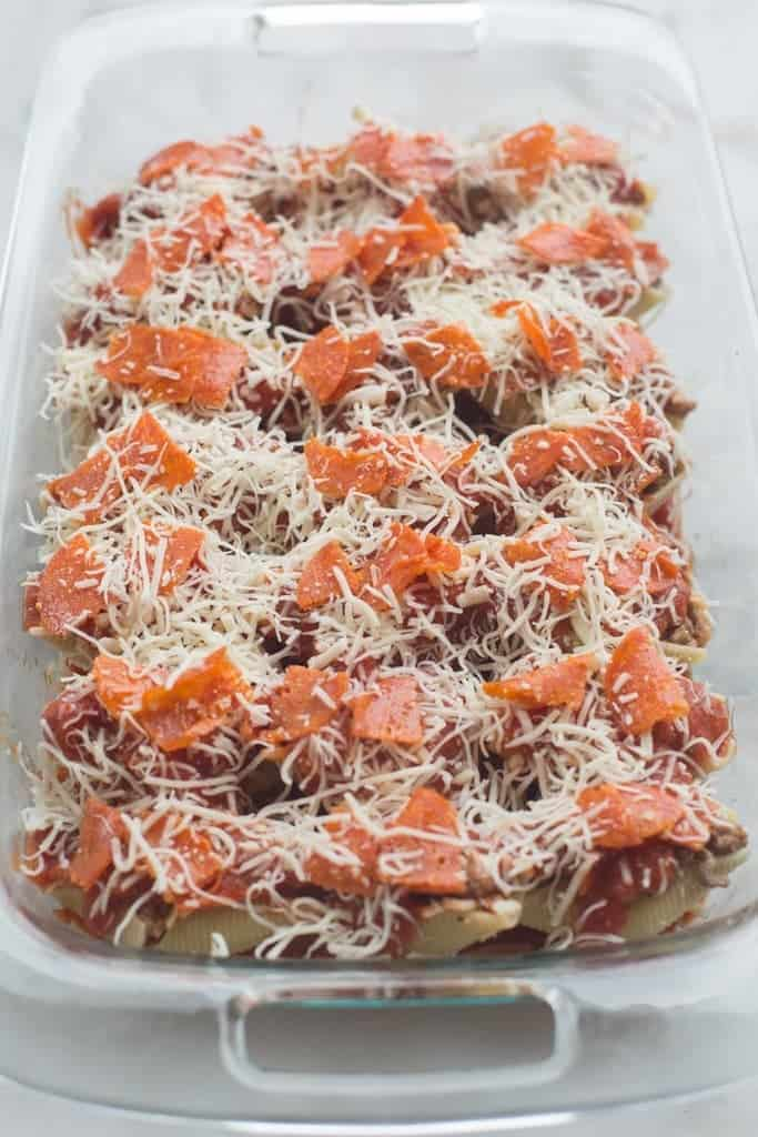 "Pizza Stuffed Shells with tender noddles filled with a ""pizza supreme"" mixture and layered with sauce, pepperoni and cheese. 