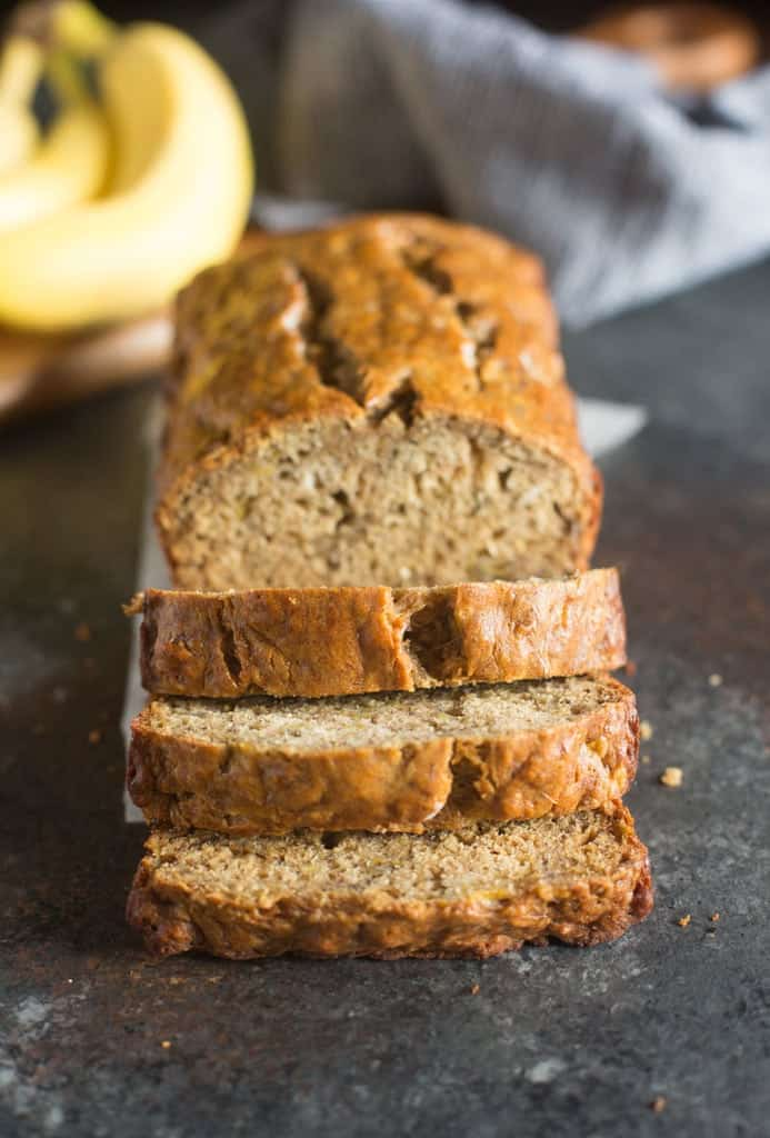 A loaf of Skinny Banana Bread with three slices cut away.
