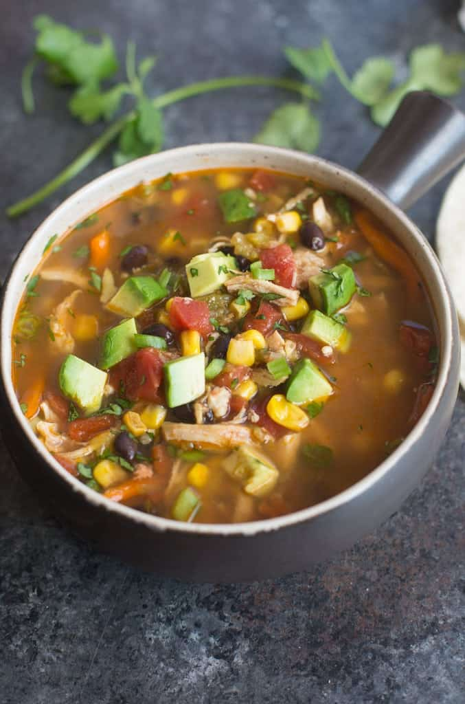"""This """"dump it and forget it"""" Slow Cooker Chipotle Chicken Fajita Soup is loaded with crazy delicious flavor, it couldn't be easier to make, and it's healthy too! 