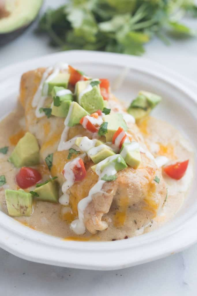 Smothered Ranch Chicken Burritos - delicious burritos, baked until crisp and then smothered in a creamy homemade ranch sauce. | Tastes Better From Scratch