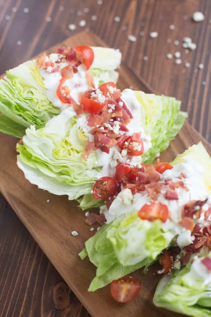 Three salad Wedge with bacon, tomatoes and a blue cheese dressing!