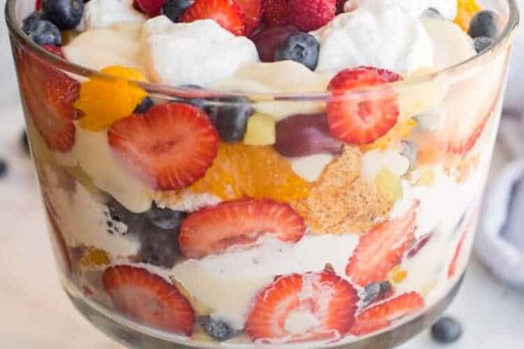 A trifle dish layered with fruit, pudding and cake.