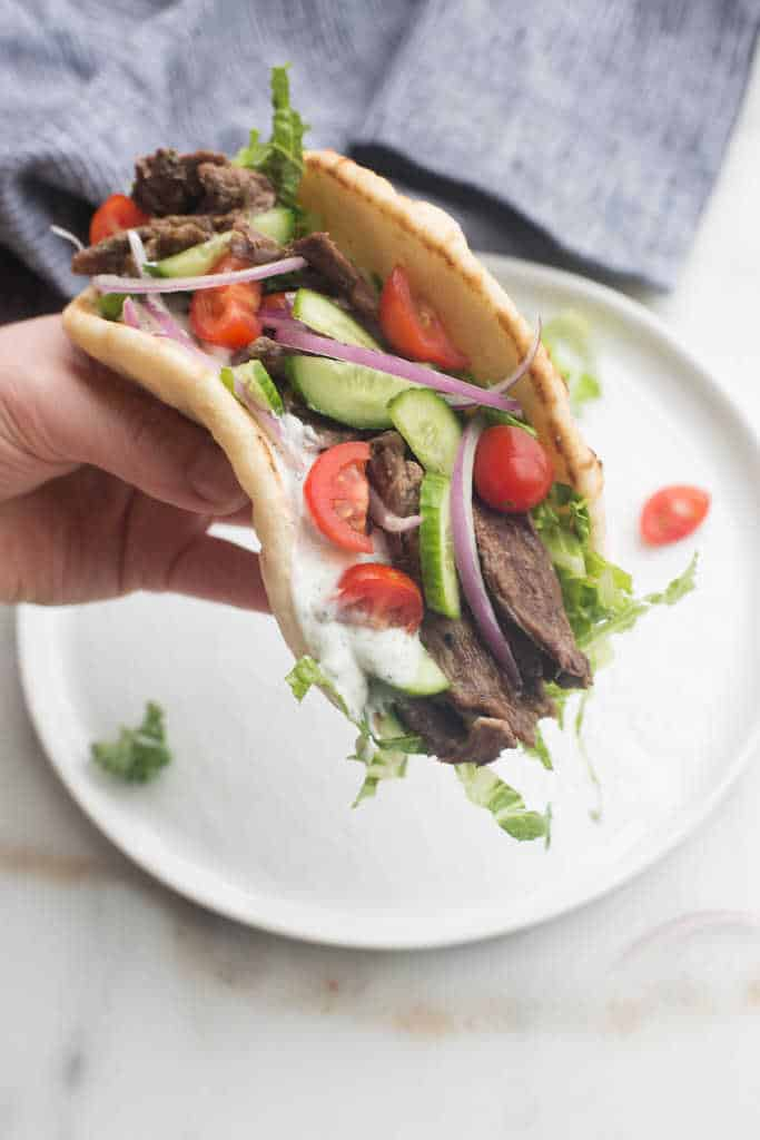 Flavorful Beef Gyro with cucumbers, tomatoes, onion, and lettuce.