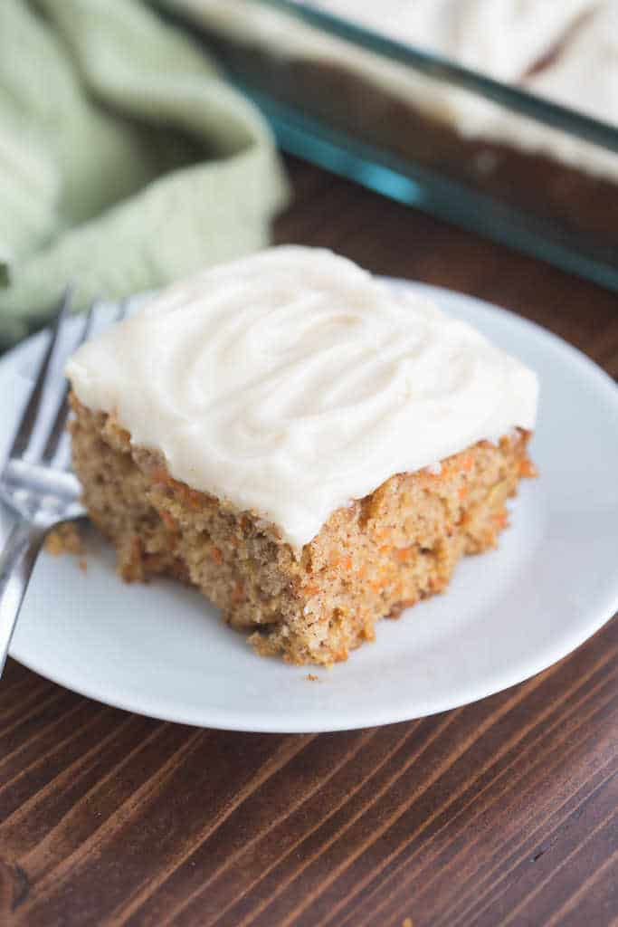 This classic, no-nonsense carrot cake recipe is The BEST! Perfectly light and moist with a light, whipped cream cheese frosting. | Tastes Better From Scratch