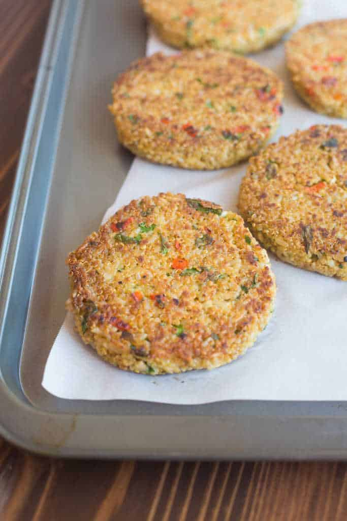 Protein-packed quinoa veggie burgers on a sheet pan.