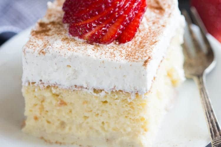 The BEST authentic homemade Tres Leches Cake. An ultra light cake soaked in a sweet milk mixture and topped with fresh whipped cream and cinnamon. This simple Mexican dessert is one of our favorites! | tastesbetterfromscratch.com