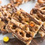 Peanut Butter and chocolate pretzel bars with Reese's pieces candy are one of our favorite simple, sweet and salty treats! | tastesbetterfromscratch.com