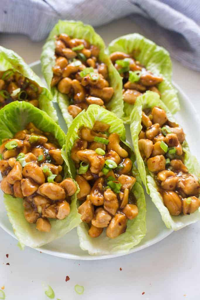 Cashew Chicken Lettuce Wraps on a white plate.