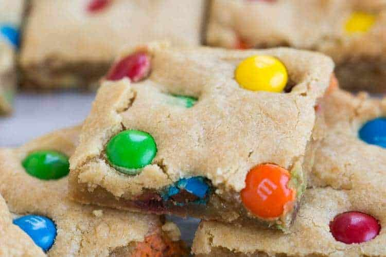These thick and chewy M&M Cookie Bars will be your new favorite! | tastesbetterfromscratch.com