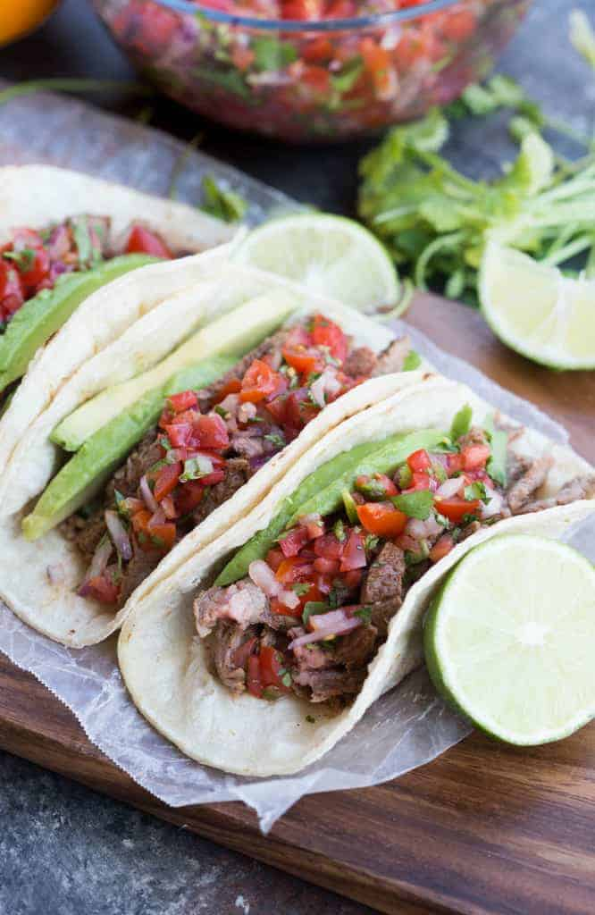 Three homemade carne asada tacos.