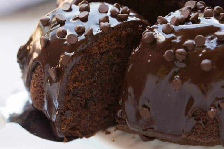 A moist, slightly dense and perfectly tender chocolate bundt cake with chocolate chips and smothered in chocolate ganache. | tastesbetterfromscratch.com