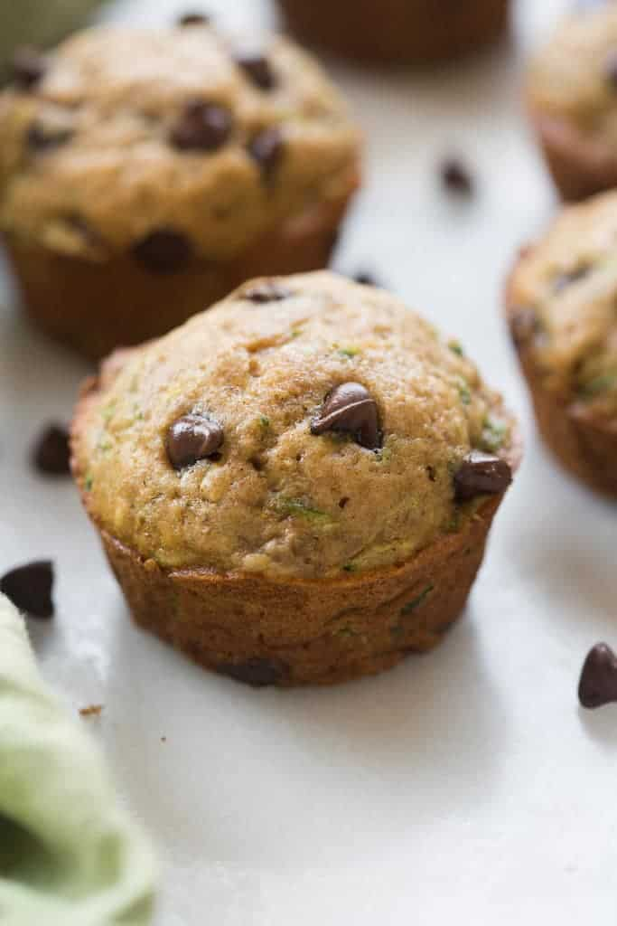 Light and tender, whole grain, chocolate chip zucchini muffins. I dare you to try and just eat one! | tastesbetterfromscratch.com