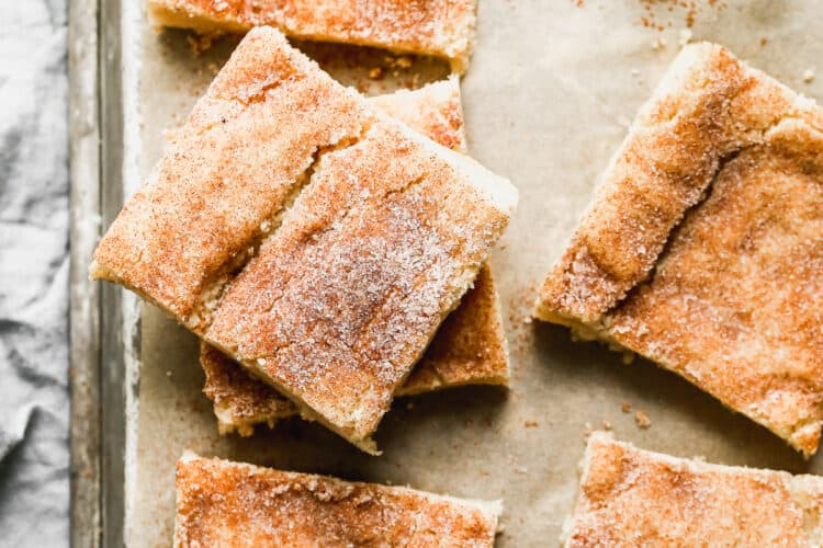 Snickerdoodle Bars cut into squares, on a baking sheet.