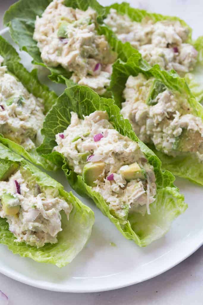 Lettuce leaves filled with a chicken salad and avocado mixture.