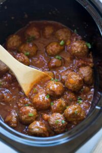 Hawaiian BBQ Meatballs made in the slow cooker or stovetop. | tastesbetterfromscratch.com