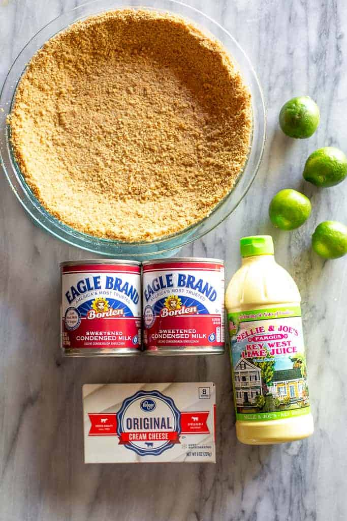 Ingredients for key lime pie: graham cracker crust, key limes, sweetened condensed milk, cream cheese and bottled key lime juice.