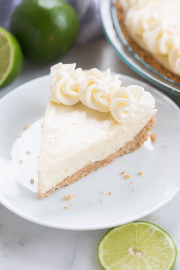 The creamiest, dreamiest, BEST Key Lime Pie recipe, that only takes 30 minutes to make! | tastesbetterfromscratch.com