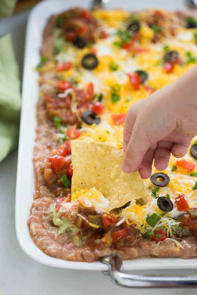 The BEST 7-layer Bean Dip | tastesbetterfromscratch.com