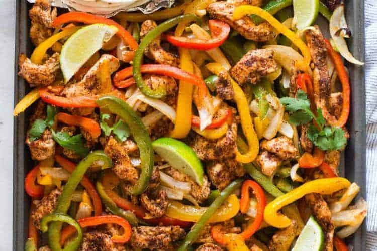 Sheet Pan Chicken Fajitas are one of my favorite easy one pan meals, and they're ready in less than 30 minutes! | tastesbetterfromscratch.com