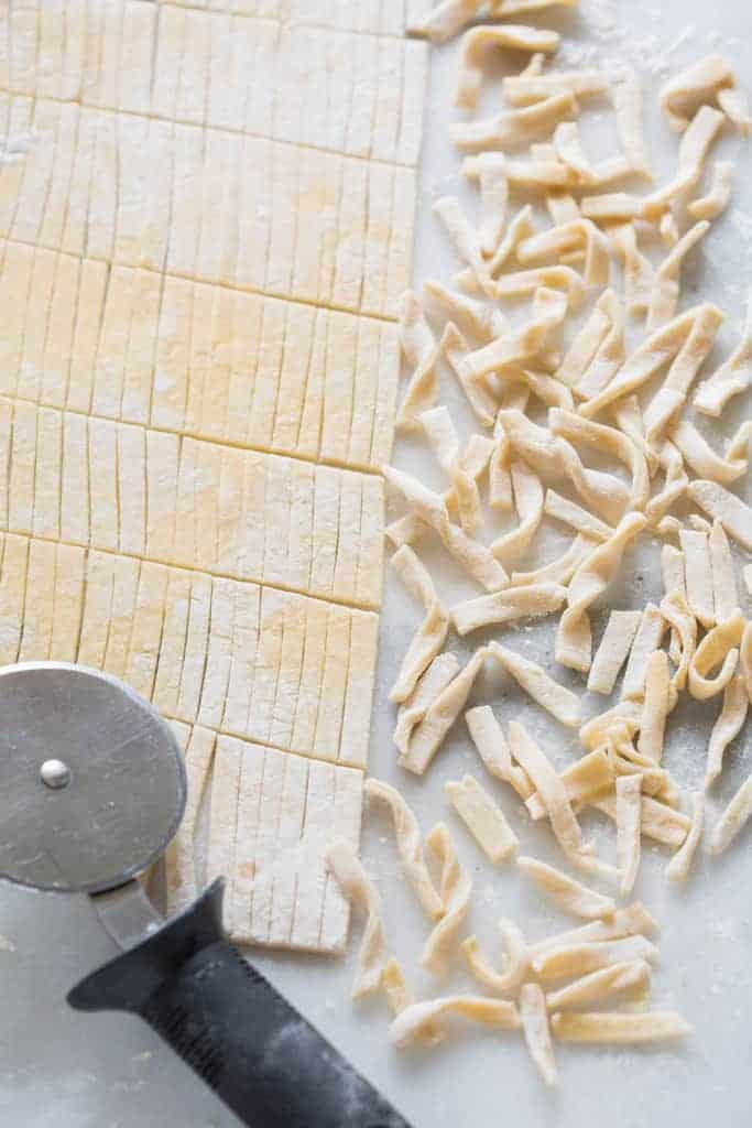 Homemade Egg Noodles with 4 simple ingredients and no special equipment needed. These delicious noodles are perfect for soups, stews, stroganoff of plain with butter and cheese. | tastesbetterfromscratch.com