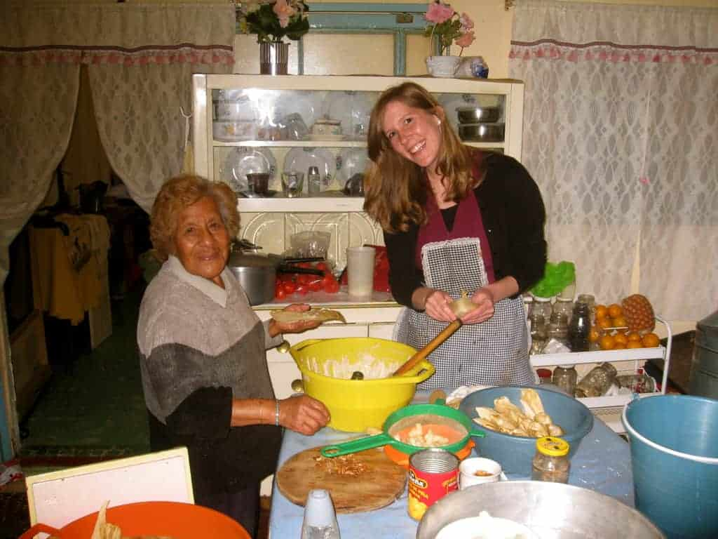 A latina Grandmother and Lauren Allen making tamales together.