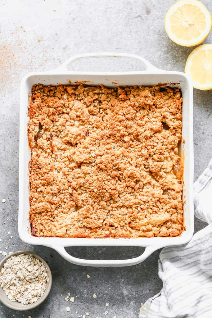A baking dish with baked apple crisp in it, hot from the oven.