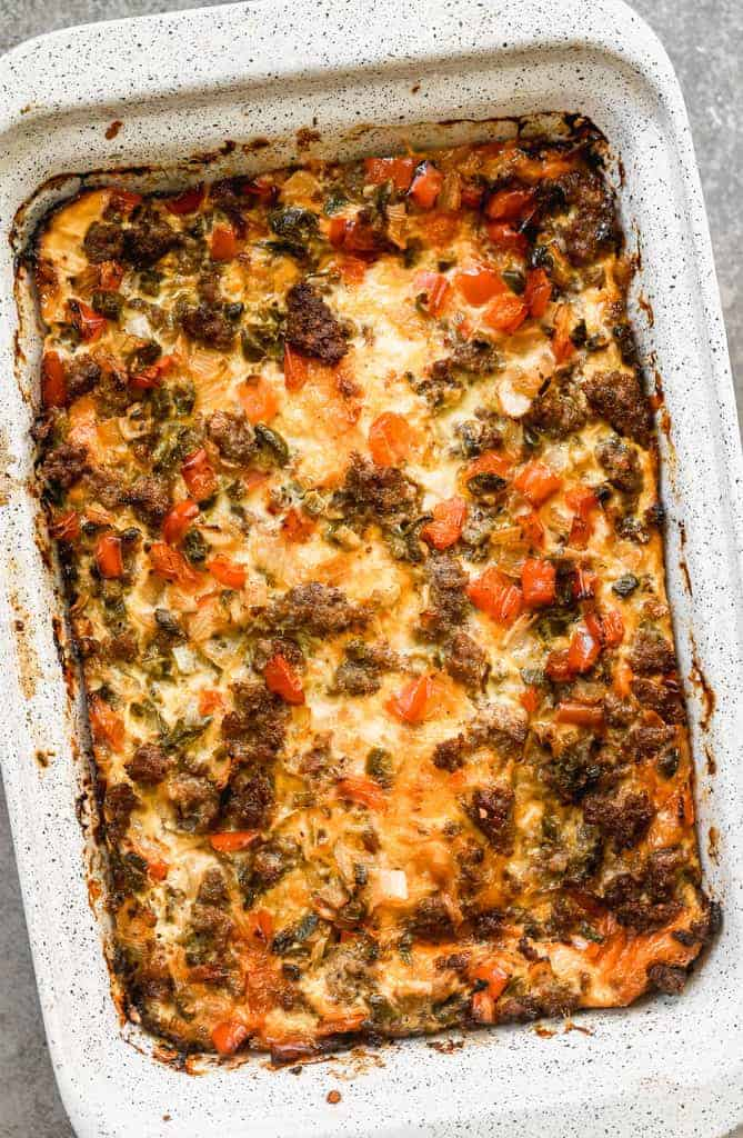 A pan of baked overnight breakfast casserole, ready to be cut and served.