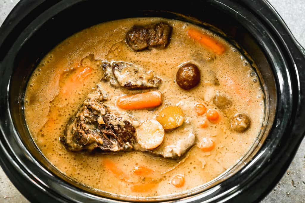 Pot Roasted in a slow cooker with gravy, potatoes and carrots.